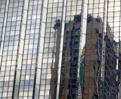 Free Stock Photo of Abstract high-rise building reflection in the glass facade