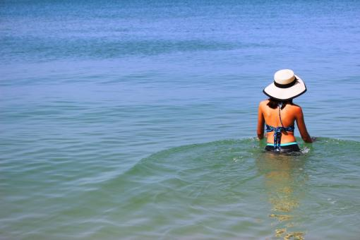 Free Stock Photo of A young woman on holiday walks and relaxes in the shallows of a tropic
