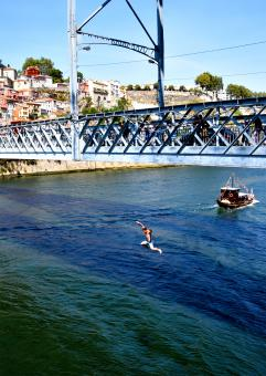 Free Stock Photo of Boy Jumping Off the Bridge Into Douro River