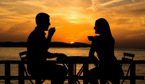 Free Stock Photo of Couple Drinking Coffee at Sunset