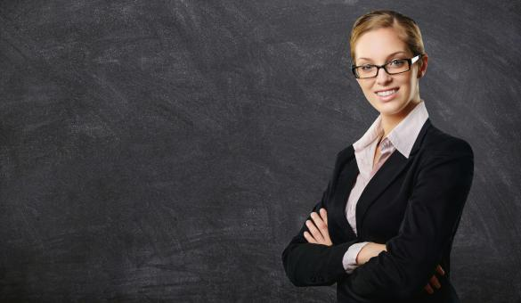 Free Stock Photo of Business Woman in front of Blackboard