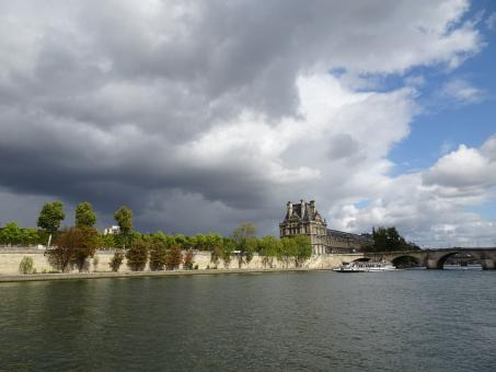 Free Stock Photo of Threatening sky over the Louvre museum and the Seine