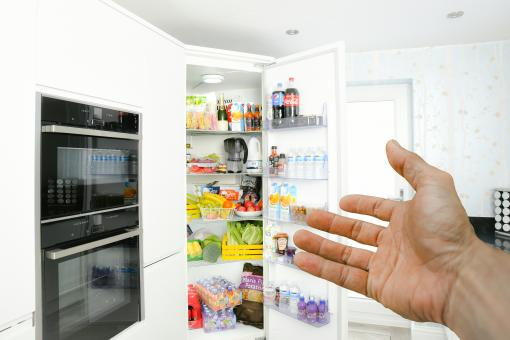 Free Stock Photo of Hand Pointing to a Full Fridge