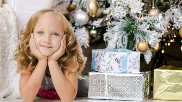 Free Stock Photo of Little Girl with Her Presents on Christmas Eve