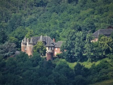 Free Stock Photo of Red sandstone (iron-rich) castle with local slate roof lining
