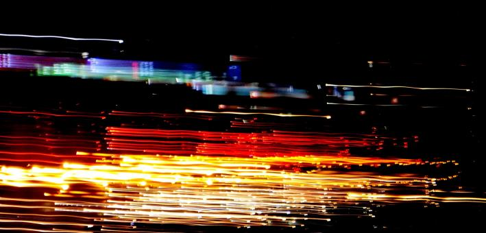 Free Stock Photo of Abstract image of night light trails in the city with motion blur