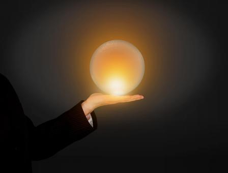 Free Stock Photo of Hand Holding Glowing Crystal Ball
