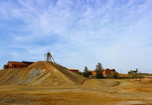 Free Stock Photo of Exterior of An Old Mine - Shaft and Tailings