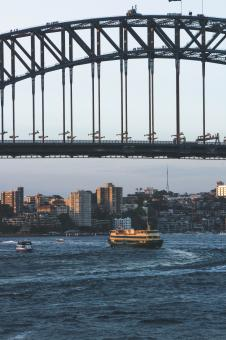 Free Stock Photo of Ferry underneath Sydney Harbour Bridge