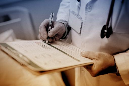 Free Stock Photo of Doctor Writing Prescription