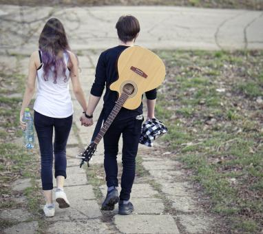 Free Stock Photo of Young couple walking