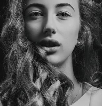 Free Stock Photo of Portrait of Young Woman in B&W