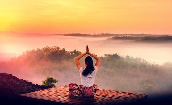 Free Stock Photo of Woman Practicing Yoga at Sunrise Over Rainforest - Dawn
