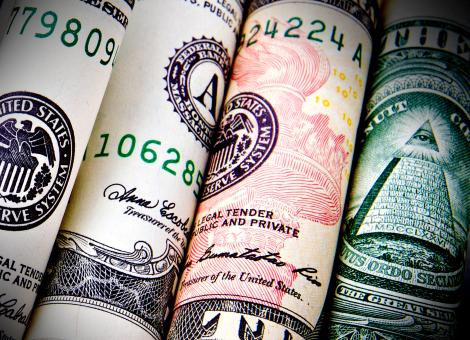 Free Stock Photo of Rolled Dollar Bills - Close-Up