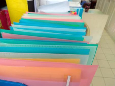 Free Stock Photo of Colorful file folders in an office