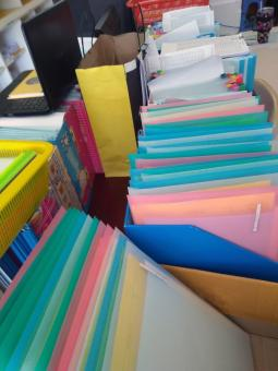 Free Stock Photo of Boxes of colorful files in an office