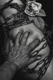 Free Stock Photo of Hand on Chained Body - Black and White