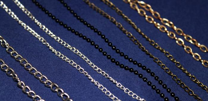 Free Stock Photo of Different metallic multi coloured chains