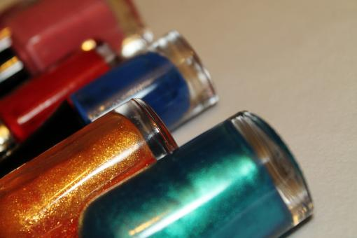 Free Stock Photo of Multi-coloured bottles of nail polish