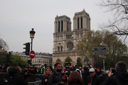 Free Stock Photo of Onlookers facing the Notre Dame Cathedral