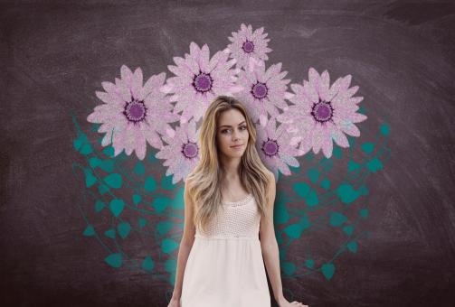 Free Stock Photo of Attractive Young Woman Over Blackboard with Flowers