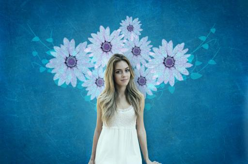 Free Stock Photo of Attractive Young Woman Over Blue Wall with Flowers
