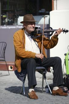 Free Stock Photo of Old man playing violin in the street