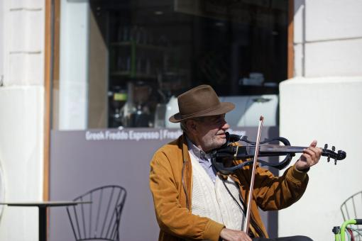 Free Stock Photo of Old man playing violin
