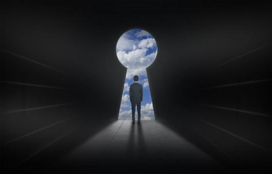 Free Stock Photo of Man and Keyhole - Opening Up a World of Possibilities