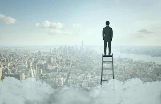 Free Stock Photo of Businessman On Top of Ladder Overlooking Manhattan