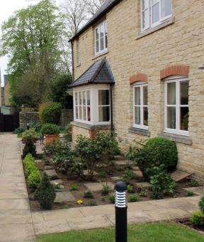 Free Stock Photo of English village style stone houses with courtyard gardens