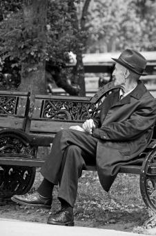 Free Stock Photo of Old Man on Bench - Black and White