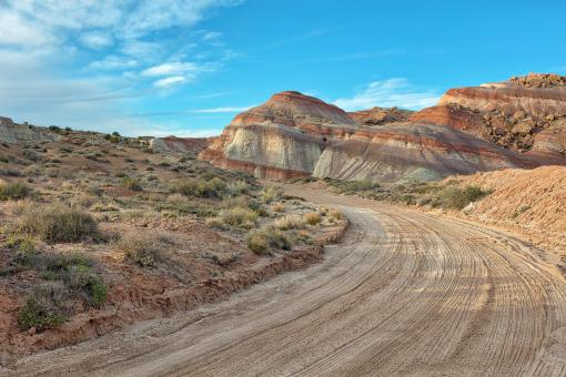 Free Stock Photo of Winding Dirt Road - Cathedral Valley