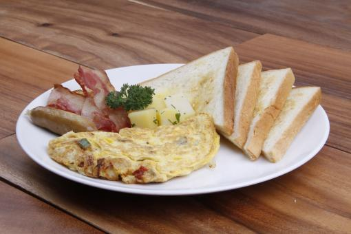 Free Stock Photo of Omelette with Toast, Bacon and Sausage