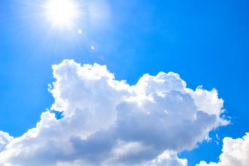 Free Stock Photo of White heap clouds and bright sun in the blue sky