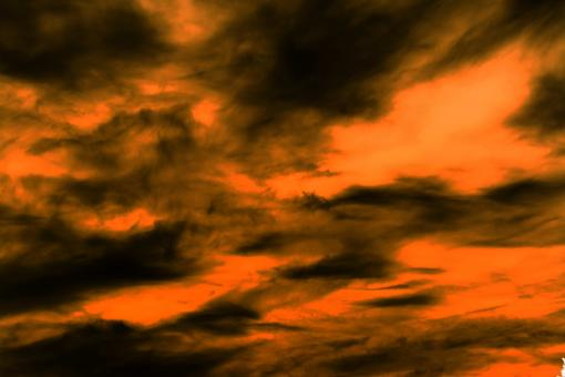 Free Stock Photo of Orange sky with dark clouds