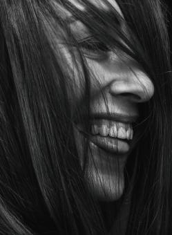 Free Stock Photo of Black and White Portrait of Laughing Girl