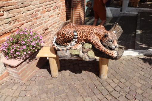 Free Stock Photo of Funny leopard sculpture near a restaurant