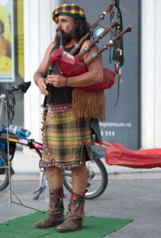 Free Stock Photo of Bearded man playing bagpipe
