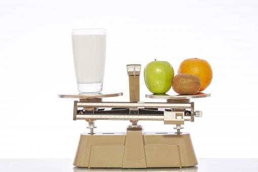 Free Stock Photo of Milk and Fruit on Scale