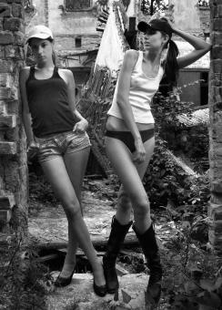 Free Stock Photo of Two Models Posing Outdoors - Black and White