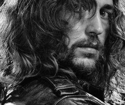 Free Stock Photo of Portrait of Man with Long Hair - Black and White