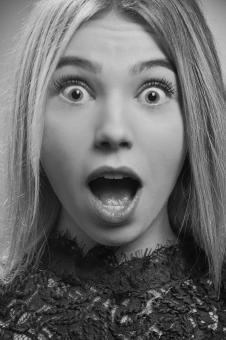 Free Stock Photo of Surprised Young Woman - Black and White