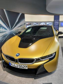 Free Stock Photo of Golden BMW i8 Luxury Car in Showroom