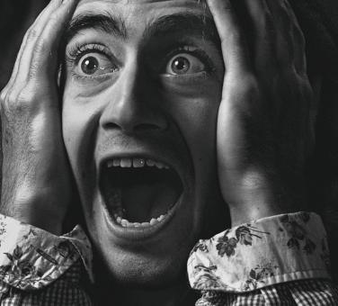 Free Stock Photo of Screaming Man - Black and White Portrait