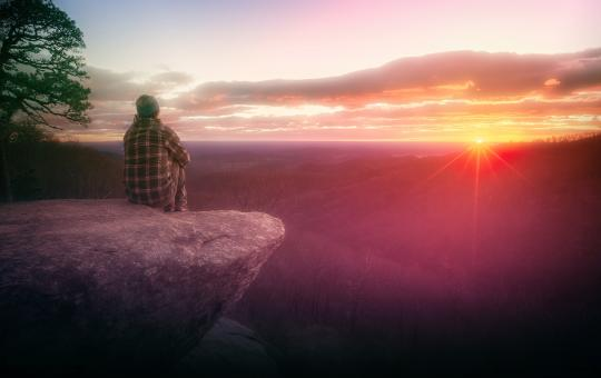 Free Stock Photo of Hiker Watching the Sunrise on Rock Ledge