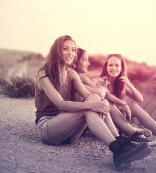 Free Stock Photo of Young Women Sitting on the Ground - Friendship
