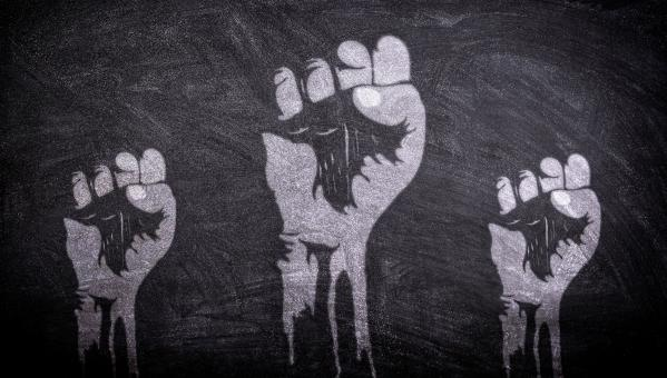 Free Stock Photo of Power to the People - Raised Fists on Blackboard