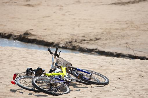 Free Stock Photo of Two old bikes on the beach