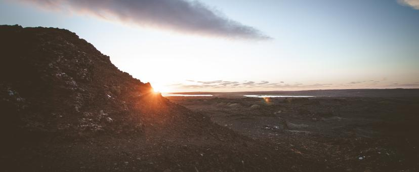 Free Stock Photo of Sun Setting Behind Lava Rocks in Iceland